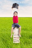 Pupil with books outdoor Royalty Free Stock Image