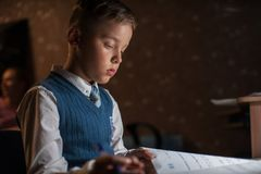 Pupil boy does his homework Royalty Free Stock Photos