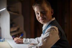 Pupil boy does his homework Royalty Free Stock Photos