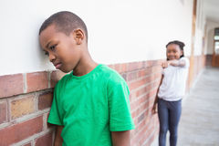 Pupil Bullying Another In The Hall Stock Images