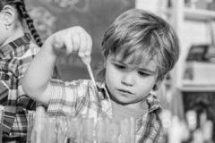 Pupil in chemistry class. back to school. Educational concept. small bopy scientist making experiments in laboratory stock photos