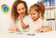 Pupil chooses cards with images at the desk Stock Image