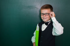 Pupil on classroom board Royalty Free Stock Image