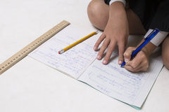 Pupil completing homework Royalty Free Stock Photography