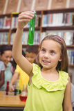 Pupil doing science in library Stock Photos