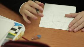 Pupil drawing house on paper stock footage