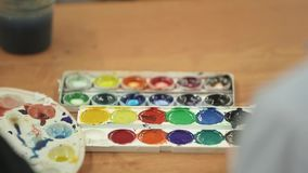 Pupil drawing and painting stock footage