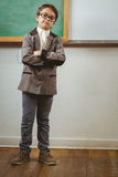 Pupil dressed up as teacher with arms crossed Royalty Free Stock Photos