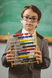 Pupil dressed up as teacher holding abacus Stock Image