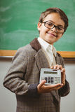 Pupil dressed up as teacher showing calculator. Portrait of pupil dressed up as teacher showing calculator in a classroom Royalty Free Stock Photo