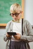 Pupil dressed up as teacher using calculator. In a classroom Stock Photography