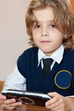 Pupil with electronic game Stock Image