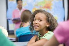 Pupil in elementary class Stock Images