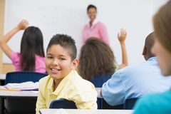 Pupil in elementary school classroom. Male pupil in elementary school classroom Stock Image