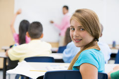 Pupil in elementary school classroom. Female pupil in elementary school classroom Royalty Free Stock Images