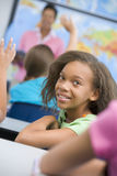Pupil in elementary school classroom. Studying geography Stock Image