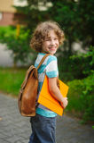The pupil of elementary school on a schoolyard. Royalty Free Stock Image