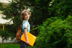 The pupil of elementary school on a schoolyard. Royalty Free Stock Photography