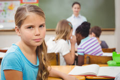 Pupil frowning at camera during class. At the elementary school Royalty Free Stock Photo