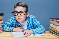 Pupil in glasses squints, bad vision concept Stock Photos