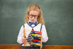 Pupil holding abacus Royalty Free Stock Photo