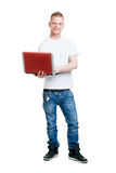 Pupil holding a notebook computer Royalty Free Stock Photography