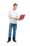 Pupil holding a notebook computer Stock Photography