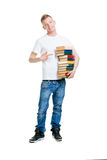 Pupil holding a stack of books isolated on white Royalty Free Stock Photo