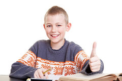 Pupil holding thumbs up Royalty Free Stock Photo