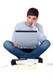 Pupil learns frustrated with books and laptop Royalty Free Stock Images