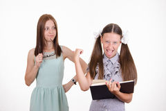 Pupil misbehaves in the classroom Royalty Free Stock Images