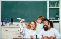 Pupil with paper airplane dreams of education. Happy school kids at lesson in September 1. Home Family math schooling -. Parents teaching kids private lessons royalty free stock image