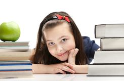 Pupil peeps out through the books Stock Photography