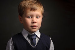Pupil portrait. Cute pupil portrait against dark classroom blackboard Stock Images