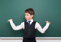 Pupil posing at school board, empty space, education concept Stock Photography