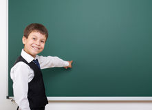 Pupil posing at school board, empty space, education concept Royalty Free Stock Photography
