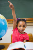 Pupil raising her hand during class Royalty Free Stock Photo