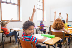 Pupil raising their hands during class Stock Photography