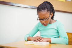 Pupil reading a school book Stock Images