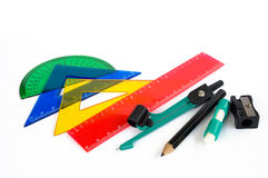 Pupil's accessories. Pen, ruler and setsquare on white background Royalty Free Stock Photo