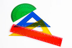 Pupil's accessories. Ruler and setsquare on white background Royalty Free Stock Image
