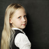 Pupil with school blackboard Stock Photography