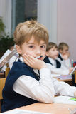 Pupil in school in the classroom. Boy sitting at the desk in the classroom Stock Photo