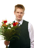 The pupil  in a school uniform with a bouquet Stock Photography