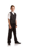 Pupil in school uniform. Full portrait of confident smiling boy in school uniform on white background royalty free stock image