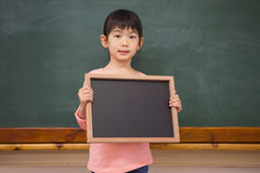 Pupil showing little blackboard Royalty Free Stock Photo