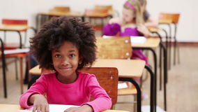 Pupil sitting at a table stock footage