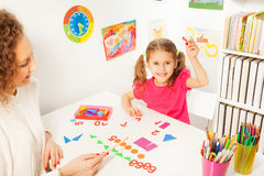 Pupil studying mathematic with teacher Stock Photography