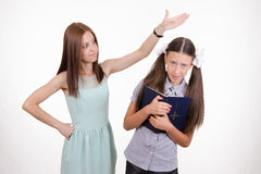 Pupil suffers from a hard teacher Stock Photo