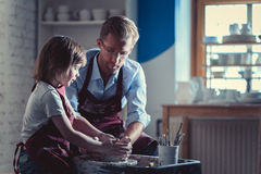 Pupil and teacher. Teacher and child in pottery Royalty Free Stock Image